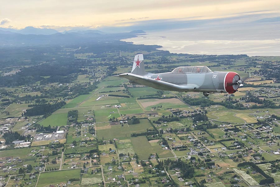 vintage plane in skies over Sequim Airport
